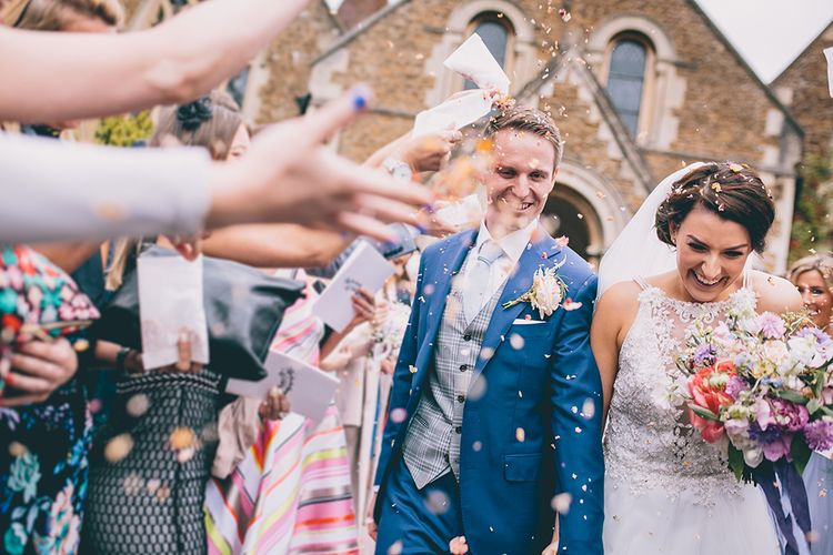 Confetti Throw | Bride in Beaded Halterneck Gown with Tulle Skirt and Spaghetti Straps by Maggie Sottero | Groom in Royal Blue Suit from Suit Supply and Tan Brogues from Barker | Halterneck Maggie Sottero Dress and Garden Games at Gate Street Barn | Story + Colour Photography