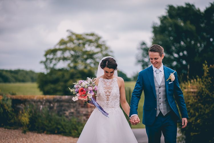 Bride in Beaded Halterneck Gown with Tulle Skirt and Spaghetti Straps by Maggie Sottero | Groom in Royal Blue Suit from Suit Supply and Tan Brogues from Barker | Pastel Wedding Bouquet with Peonies | Halterneck Maggie Sottero Dress and Garden Games at Gate Street Barn | Story + Colour Photography