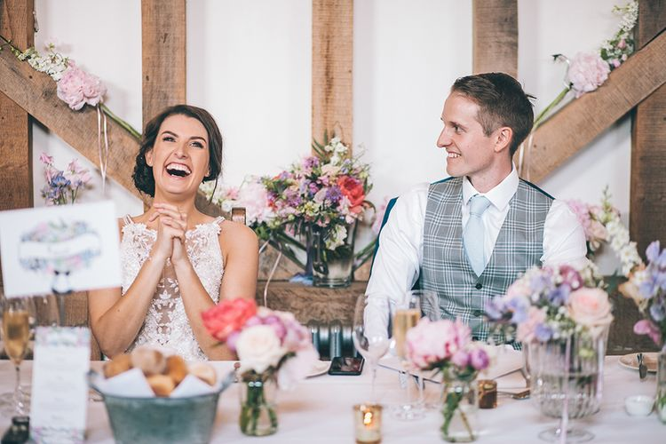 Speeches | Bride in Beaded Halterneck Gown with Tulle Skirt and Spaghetti Straps by Maggie Sottero | Groom in Royal Blue Suit and Pastel Blue Tie from Suit Supply | Top Table | Pastel Flowers | Halterneck Maggie Sottero Dress and Garden Games at Gate Street Barn | Story + Colour Photography