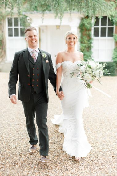 Bride in Off the Shoulder St Patrick Wedding Dress and Groom in Three Piece Suit