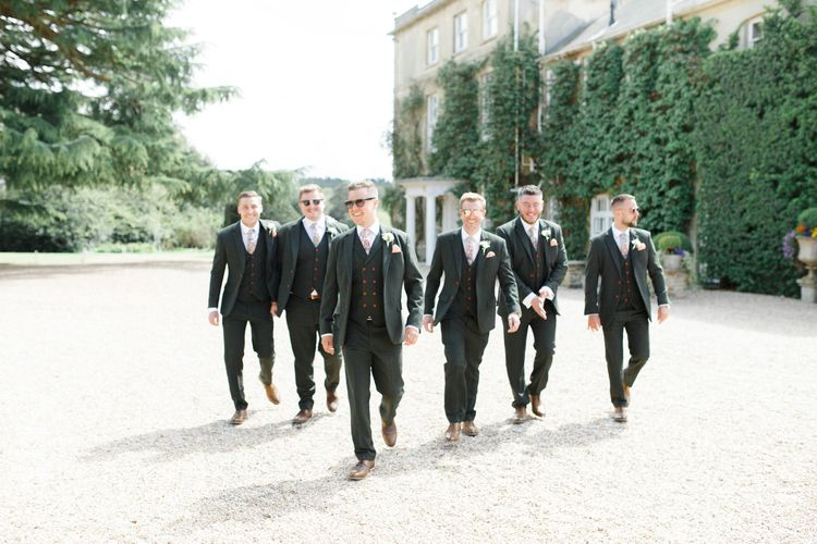 Groomsmen in Matching Grey Suits with Red Buttons