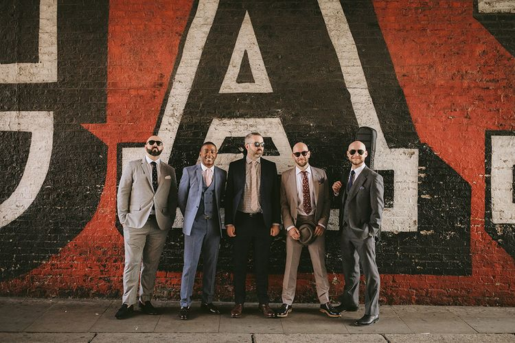 Groom and Groomsmen | Groom in Grey Puppy Tooth Check Two-Piece Paul Smith Suit with Amber Tie Pin, Pocket Square, Braces and Hat with Feather | Bike Shed Motorcycle Club Wedding for ELLE Digital Editor | Nigel John Photography