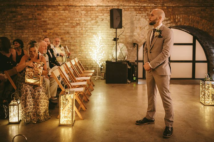 Wedding Ceremony | Groom in Grey Puppy Tooth Check Two-Piece Paul Smith Suit with Amber Tie Pin, Pocket Square and Braces | Bike Shed Motorcycle Club Wedding for ELLE Digital Editor | Nigel John Photography