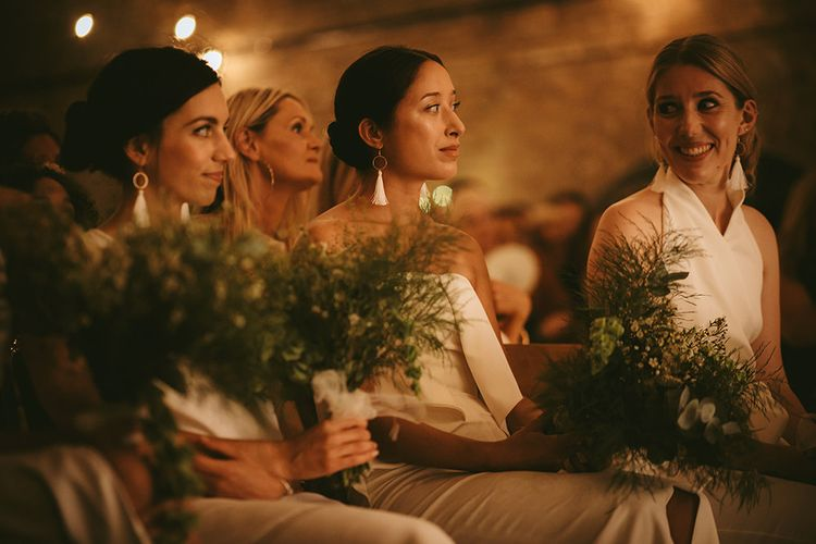 Wedding Ceremony | Bridesmaids in Mismatched White Dresses | Homemade Bouquets of White Flowers, Ferns and Foliage | Bike Shed Motorcycle Club Wedding for ELLE Digital Editor | Nigel John Photography