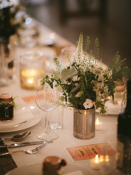 Wedding Reception Décor | Wooden Trestle Tables with White Runner | White Flowers, Ferns and Foliage in Tin Can | Tea Lights | Bike Shed Motorcycle Club Wedding for ELLE Digital Editor | Nigel John Photography