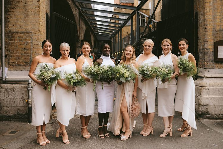 Bride in Bespoke Wedding Gown with Blush Underskirt and One Off Shoulder Strap | Nude Topshop Shoes with Pom Pom | Bridesmaids in Mismatched White Dresses | Homemade Bouquets of White Flowers, Ferns and Foliage | Bike Shed Motorcycle Club Wedding for ELLE Digital Editor | Nigel John Photography