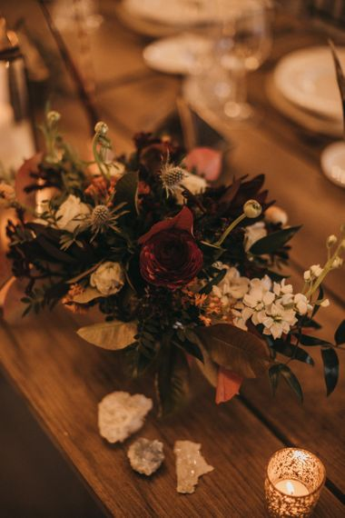 Burgundy, White and Blush Flower Centrepieces | Crackle Gold Tea Light Holders | Mineral Rocks | Festival Wedding with Naked Tipi Chill Out Area, Lace Bridal Separates, Feather Flower Crown and Protea Bouquet | Serafin Castillo
