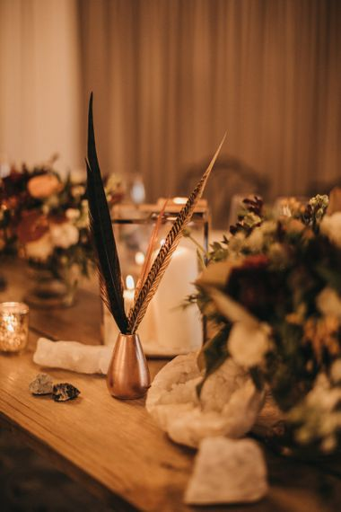 Feathers | Mineral Rocks | Crackle Gold Tea Light Holders | Gold Lantern | Pillar Candles | Festival Wedding with Naked Tipi Chill Out Area, Lace Bridal Separates, Feather Flower Crown and Protea Bouquet | Serafin Castillo