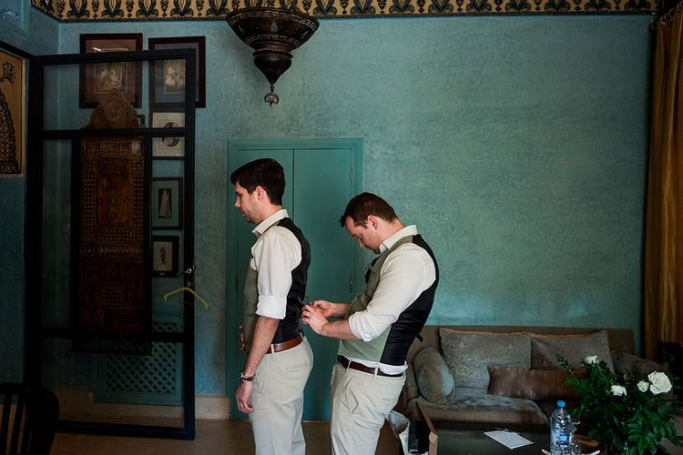 Groomsmen Preparations | Groom in Green Beggars Run Suit | Paradise Destination Wedding at Jnane Tamsna in Marrakech, Morocco | Nordica Photography | Matteo Castelluccia Film
