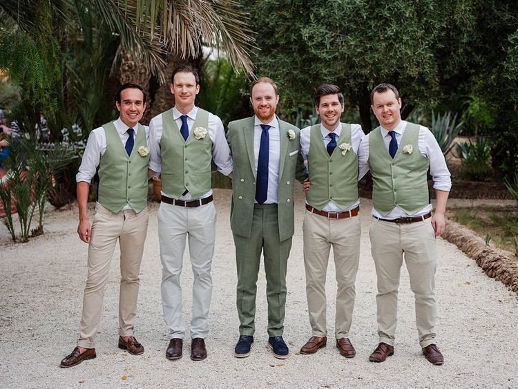 Groomsmen in Green Beggars Run Suits | Paradise Destination Wedding at Jnane Tamsna in Marrakech, Morocco | Nordica Photography | Matteo Castelluccia Film