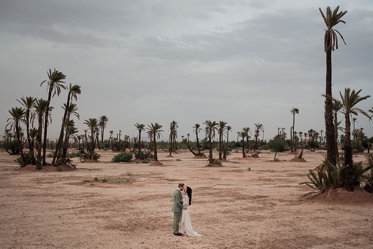 Bride in rue de Seine Bridal Gown | Groom in Green Beggars Run Suit | Paradise Destination Wedding at Jnane Tamsna in Marrakech, Morocco | Nordica Photography | Matteo Castelluccia Film