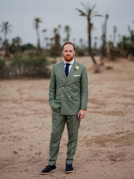 Groom in Green Beggars Run Suit | Paradise Destination Wedding at Jnane Tamsna in Marrakech, Morocco | Nordica Photography | Matteo Castelluccia Film