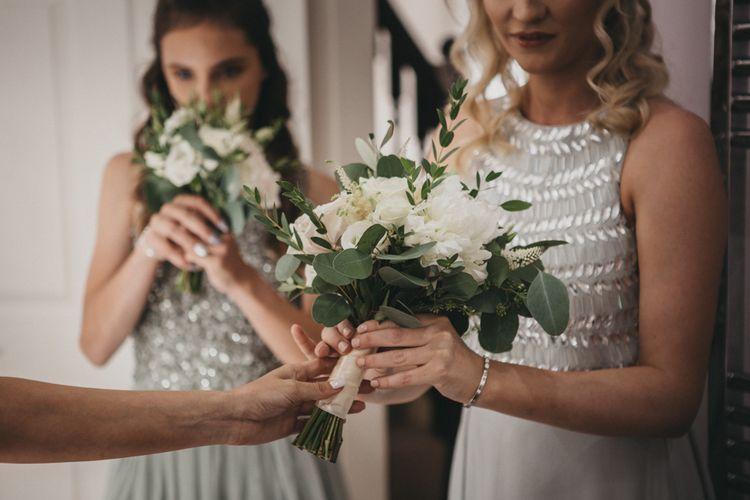 Bridesmaids in Grey Jewel Dresses Holding Posies