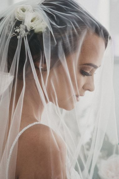 Beautiful Bride with Sheer Veil Over Her Face