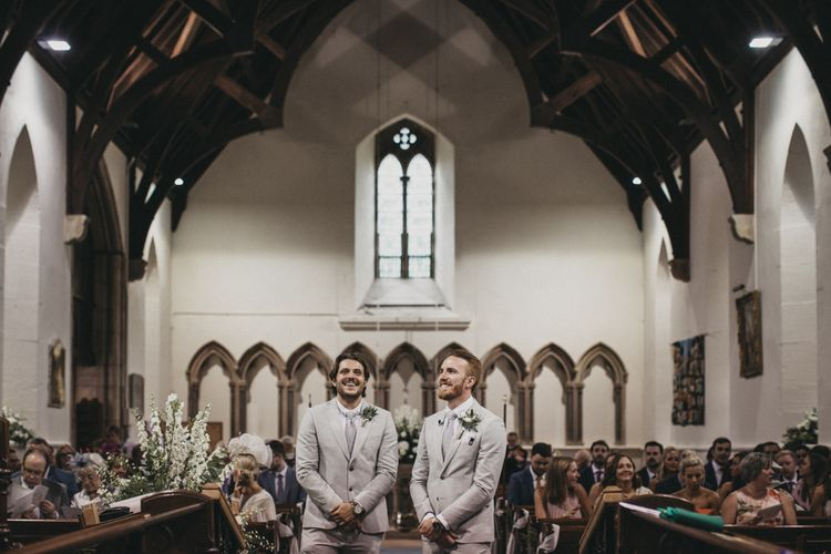 Groomsmen at the Altar in Light Grey Moss Bros. Suits