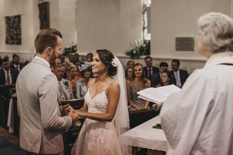 Church Wedding Ceremony with Bride in Martina Liana Wedding Dress and Groom in Light Grey Moss Bros. Suit