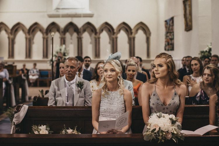 Bridesmaids in Different Grey Dresses Sitting in the Church