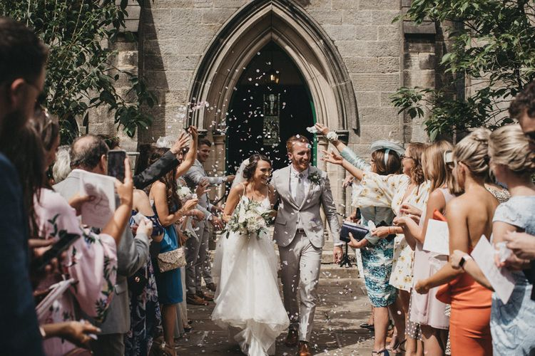 Church Confetti Exit with  Bride in Martina Liana Wedding Dress and Groom in Light Grey Moss Bros. Suit