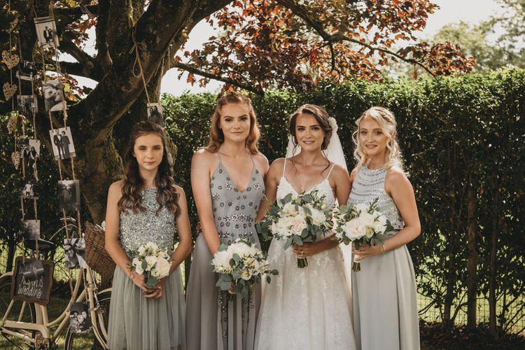 Bridal Party in Grey Bridesmaid Dresses and Bride in Martina Liana Wedding Dress