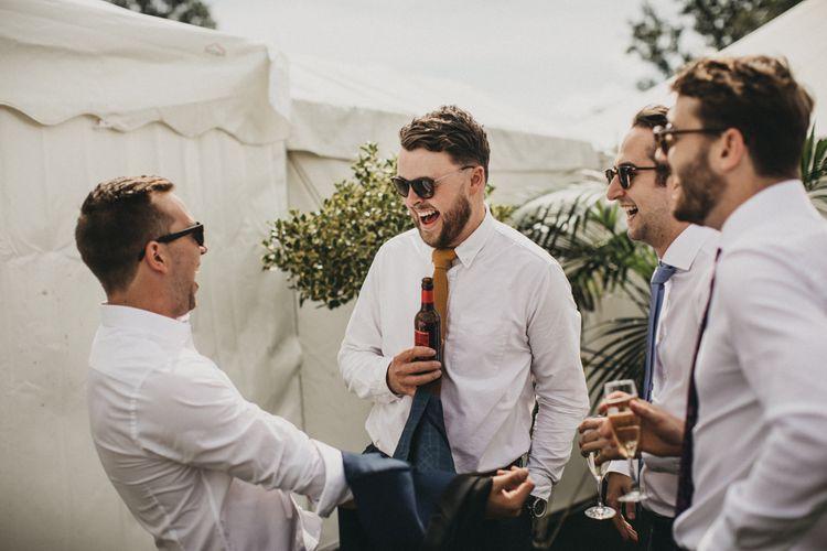 Groomsmen Laughing, Joking and Having a Beet Together