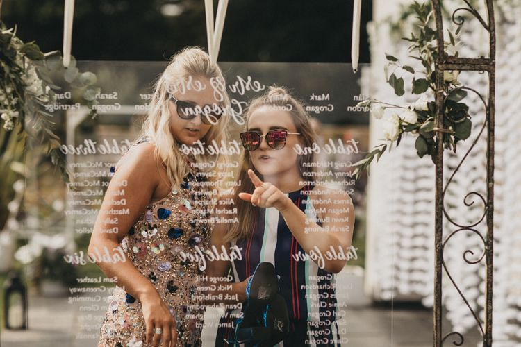 Wedding Guests Reading the Acrylic Seating Chart