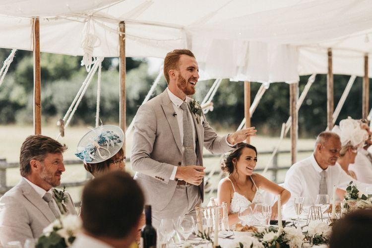 Groom in Light Grey Moss Bros. Suit Giving His Wedding Speech
