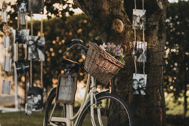 Vintage Bicycle Wedding Decor with Hanging Black and White Portraits