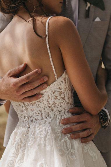 Groom Embracing His Bride in Lace Martina Liana Wedding Dress