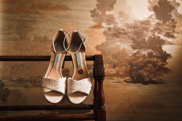 Bridal shoe detail at sophisticated autumn celebration