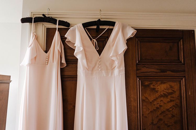 Cold frilled shoulder bridesmaid dresses with delicate button detailing