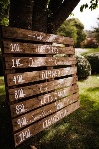 Wooden palette order of the day for relaxed autumn outdoor Dewsall Court wedding