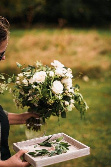 Beautiful white flower bouquet for sophisticated outdoor ceremony