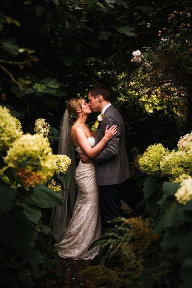 Bride and groom steal a moment at outdoor celebration in autumn