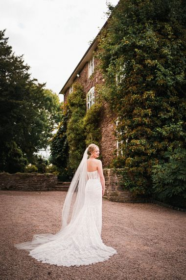 Back of brides strapless gown with beaded detailing at Dewsall Court wedding