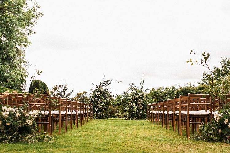 Outdoor autumn wedding ceremony at Dewsall Court wedding  with floral arch