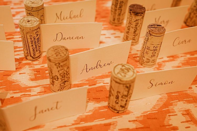 Personalised table setting cards using wine corks for barn reception