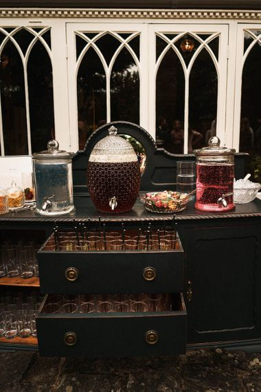 Reception drinks station with drinks dispensers and fruit to personalise