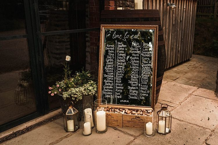 Mirror table plan with lantern candles at sophisticated autumn celebration