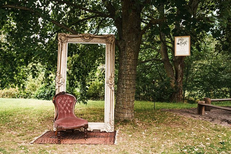 Outdoor sophisticated photo booth at Dewsall Court wedding