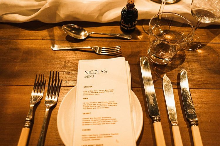 Stationary details for personalised menus and table settings at barn reception