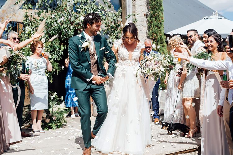 Confetti Moment | Bride in Antonia Berta Muse Wedding Dress | Groom in Navy Suit | Rustic Greenery Wedding at Cripps Barn Cotswolds | Wedding_M Photography