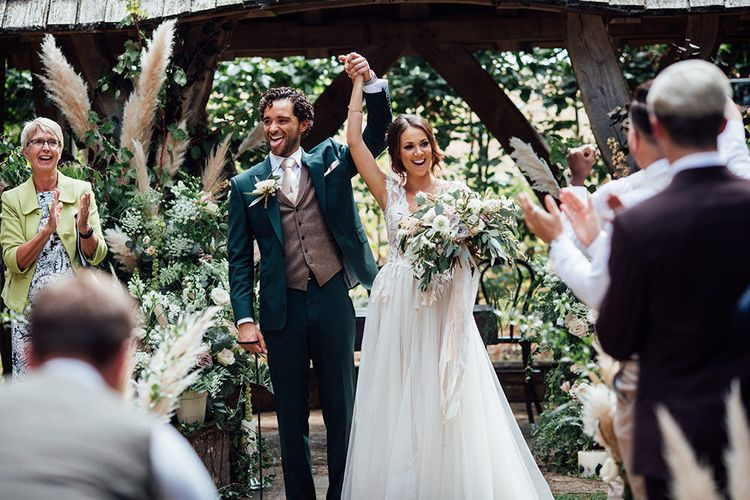 Wedding Ceremony | Bride in Antonia Berta Muse Wedding Dress | Groom in Navy Suit | Rustic Greenery Wedding at Cripps Barn Cotswolds | Wedding_M Photography