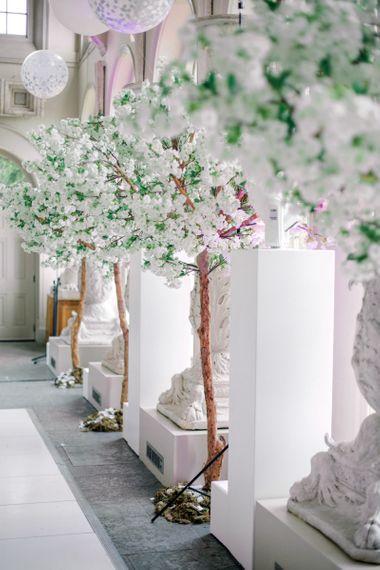 White Blossom Trees Lining the Dance Floor