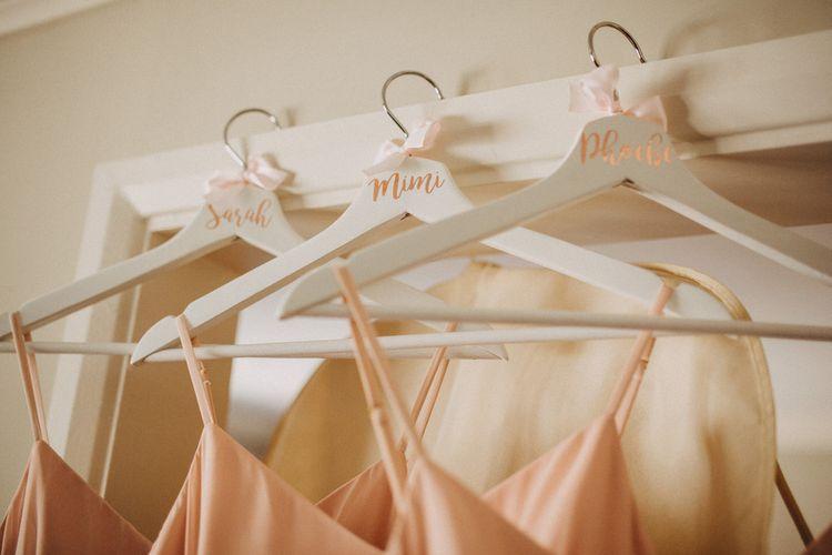 Personalised hangers for blush bridesmaid dresses