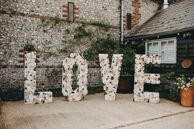 Freestanding large letters with blush flowers