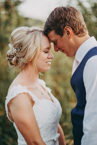 Bride with pinned updo  and groom