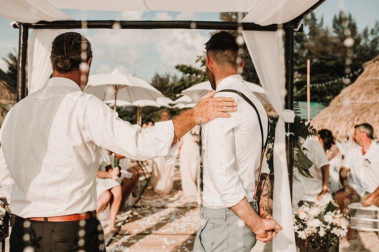 Groom at the Altar in Peach Bow Tie & Braces | Tropical Destination on the Beach at Nice Sea Resort, Koh Phangan Thailand Planned by Phangan Weddings | Carla Blain Photography