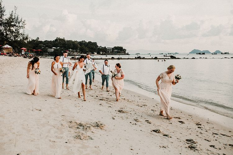 Wedding Party | Bridesmaids in Peach Gowns | Bride in Grace Loves Lace Gia Wedding Dress | Groomsmen in Turned Up Trousers, Bow Ties & Braces from Topman | Tropical Destination on the Beach at Nice Sea Resort, Koh Phangan Thailand Planned by Phangan Weddings | Carla Blain Photography