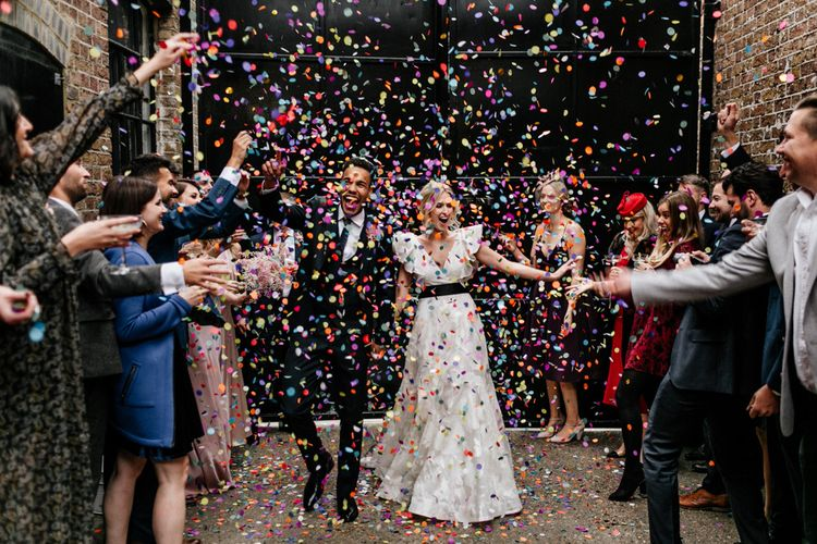 Colourful Confetti Moment with Bride in Ruffle Wedding Dress