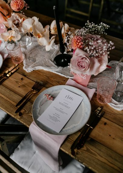 Place Setting with Ornate Plate, Menu Card, and Blush Linen